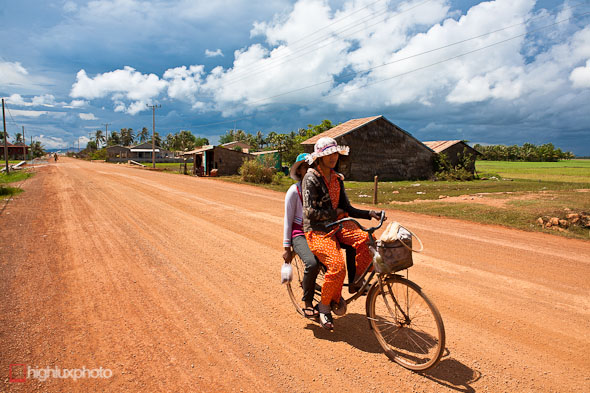 cambodian girls on bicycle