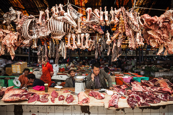Butcher, Zhongdian market. Yunnan, China.