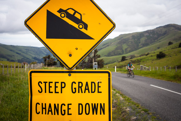 Morning of day three we were out of our bivvy bags early and got stuck into the long climb out of Little Akaloa to the summit road. The sign says it all...