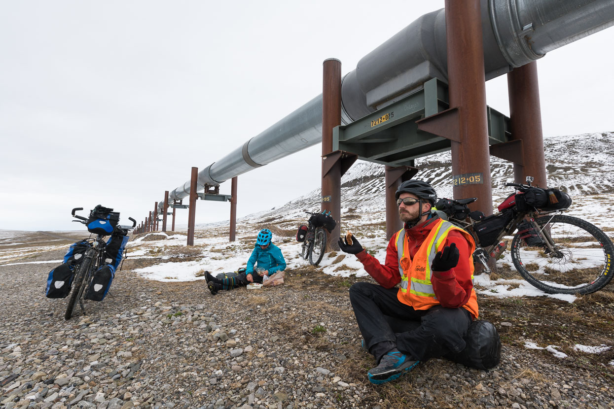 Lunch under the pipeline. Some clever mechanisms prevent the warm oil from melting the permafrost (and undermining the foundations) by cooling the supports with refrigerant. We had to isolate ourselves from the ground to prevent the permafrost from freezing us!