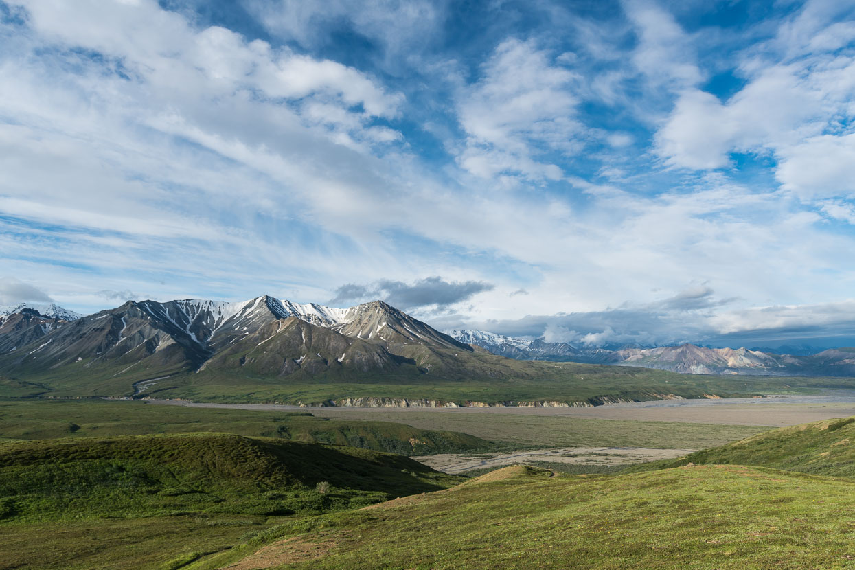 View from the Eilson Visitor Centre, near Thorofare Pass. Toklat River and Denali River valley. Denali hidden in cloud.
