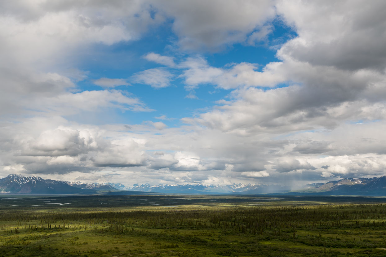 Sweeping views towards the Alaska Range from the high ground followed by the road.
