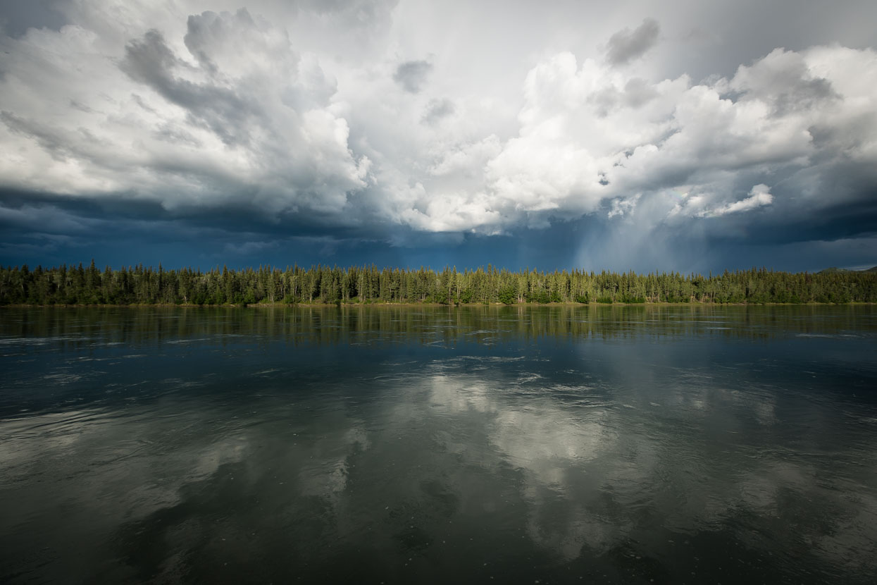 A thunderstorm brews beyond the Yukon River at Carmacks, another small town along the highway. The river is a couple of hundred metres wide at this point, dead flat, deep and swiftly moving. We camped a stone's throw from the banks in a small privately run campground.