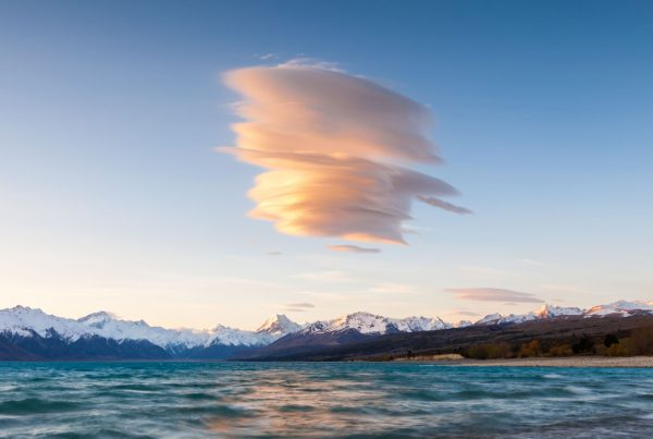 Wind cloud formed over Lake Pukaki, Aoraki Mount Cook and the Southern Alps. Canterbury, New Zealand.